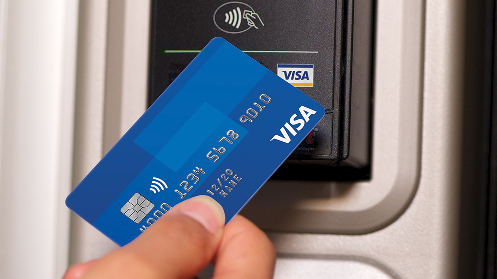 Tapping Visa card  with Visa's contactless payments system.